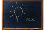 Light Bulb Drawn on Chalkboard --- Image by © Lawrence Manning/Corbis